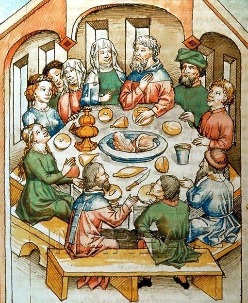 Középkori lakoma terített asztala egyetlen késsel és pohárral, fedeles sótartóval, fatányérokkal, a jólétet jelképező kenyérrel és sültes tállal egy osztrák kézirat miniatúráján (1463 • Forrás: pinterest.com)