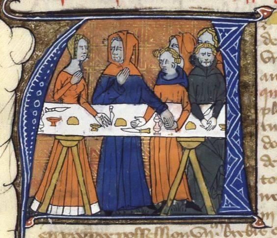 Ideiglenesen felállított, étkezés után szétbontható asztal (lábakra helyezett asztallap) egy 14. századi Biblia díszes kezdőbetűjében (Wikipédia)