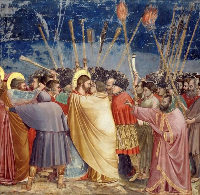 A képzőművészetben hagyománnyá vált az árulást és a hűtlenséget jelképező sárga vagy narancssárga köpenyben ábrázolni Iskarióti Júdást (Giotto di Bondone: Júdás csókja a padovai Scrovegni-kapolna falképén, 1305 körül) • Forrás: Wikimedia Commons